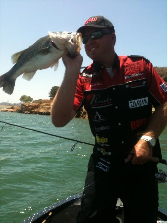 SoCal Bass Fishing Guide Rusty Brown hoists a chunk largemouth bass
