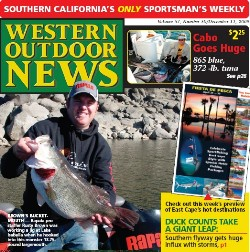 Rusty Brown catches a 13.75 lb largemouth bass and lands the cover of Western Outdoor News